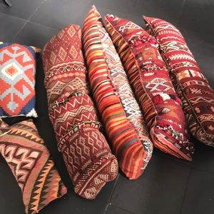 Bundle of 7 antique Moroccan pillows. rugs as well